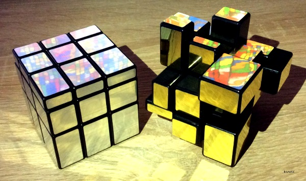 solved and scrambled mirror cube puzzle