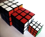 various sized rubik's cubes from small to big
